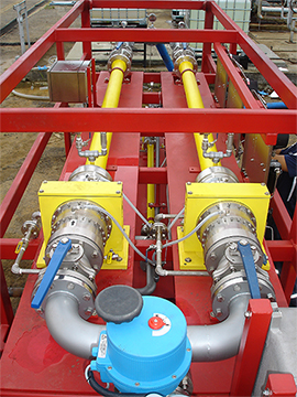 side view: a complete turnkey system that includes three Voraxial® Separators working in parallel and in series, separating sand from water at rates of up to 30,000 barrels per day. The Voraxial® system is installed via hose connection