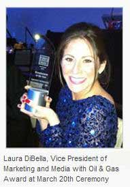 laura dibella healy with trophy from oil & gas awards